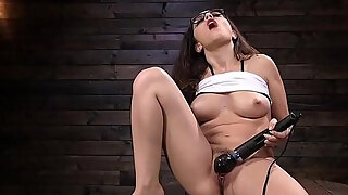 brunette receives pumping machine from behind