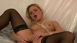 sexy milf fucks herself in stockings heels