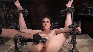 brunette fastened in contraption twat lashing